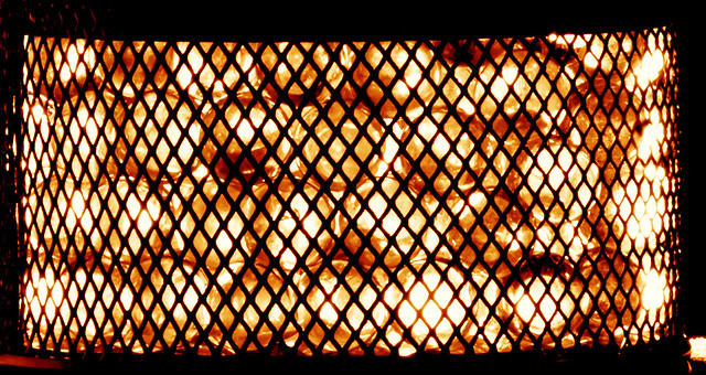 Behind the grate, balls of fire