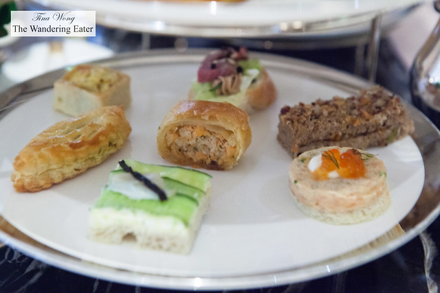 Savory pastries and tea sandwiches on the lower tier