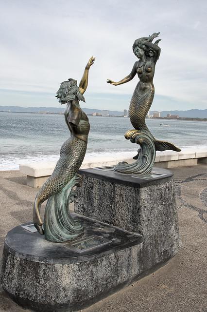 Malecon statues.