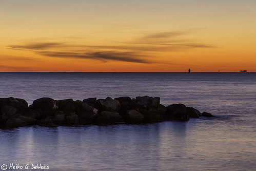 lighthouse water sunrise virginia rocks first orangesky hampton newyearsday chesapeakebay buckroebeach