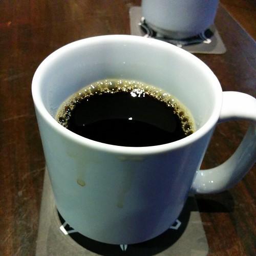Delayed flight. Drinking coffee.