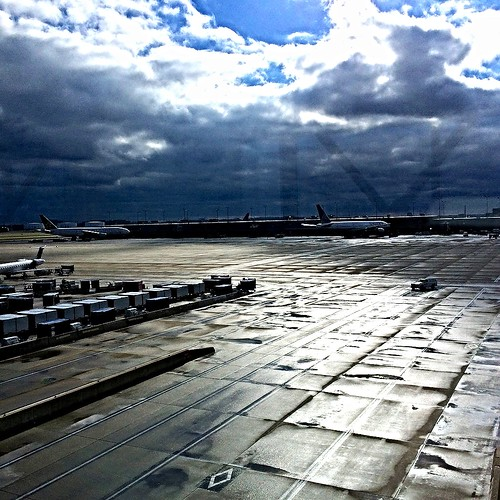 weather tarmac clouds plane airplane airport dulles