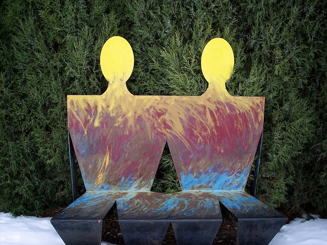 Two Colorful Characters on a Bench