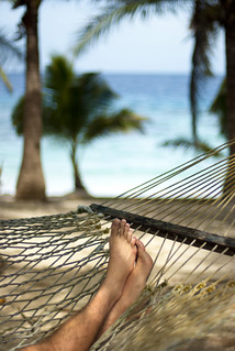 Man relaxing in a hammock   by Photo Everywhere