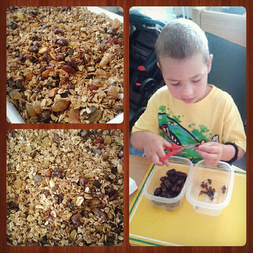 We made homemade granola (or muesli, as it's known here) today! Zak made an excellent chef's assistant- cutting dates, fetching and prong away ingredients,  and pouring them in.  Can't wait to eat some! #homemade #granola #cookingwithkids #norefinedsugaro | by who_da_fly