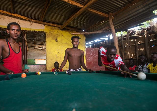 Young men playing snooker pool, Omo valley, Kangate, Ethiopia