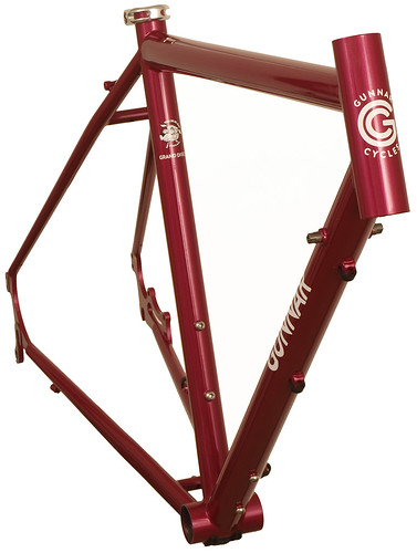 <p>Front view of Gunnar Cycles' Grand Disc fully the supports the loaded tourer with durable construction, double rear eyelets, three sets of water bottle bosses.  The comfort fit makes every mile a pleasure to ride.  Shown here in Rosewood Metallic.</p>