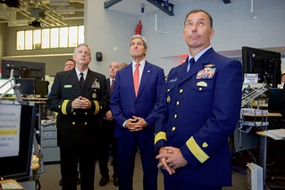 Secretary Kerry Look at Overheard Screen Dring a Briefing at the Maritime Operations Center