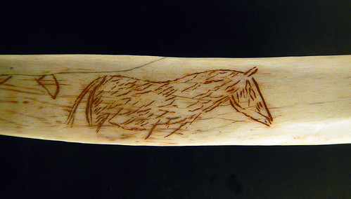 Horse carved on a bone found in the Cuevas Tito Bustillo in Spain