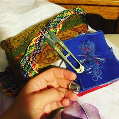 #sewphotohop Essential kit? My hand sewing kit: Thread plait, scraggy fabric needle holder, Valyrian steel snips and thimble. That's all I need. That and the wine, chocolate and boomerang just out of shot. And the remote control. @houseofpinheiro @reddski