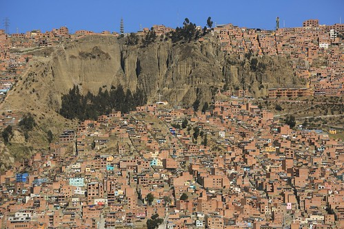 city travel houses people mountain snow southamerica landscape religious photography haze community scenery cross religion peak dry sunny bolivia security erosion views geology lapaz arid altiplano highaltitude dwellings topography whitecross mountainous eriagn ngairelawson ngairehart