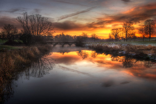 bridge red sky orange tree water misty