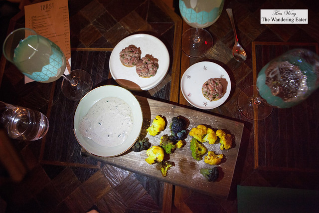Snacks: Broccoli, treviso, celery salt and chorizo & Beef tartare, chives, black pepper cracker
