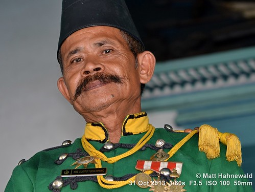 kraton uniform moustache hat male ethnic portrait posing soldier primelens travel character street eyes traditional asia flash matthahnewaldphotography face facingtheworld fez peci tarboosh head indonesia java medal nikond3100 indonesian outdoor lowangle southeastasia surakarta 50mm livedinface expression headshot nikkorafs50mmf18g colourful colour person emotional closeup consensual lookingatcamera seveneighthsview
