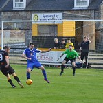 Dennis Wyness fires in a shot as Christopher Ross looks to block