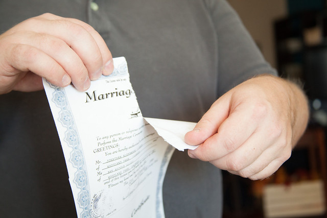 Divorce - torn marriage license | A man tearing a marriage c… | Flickr