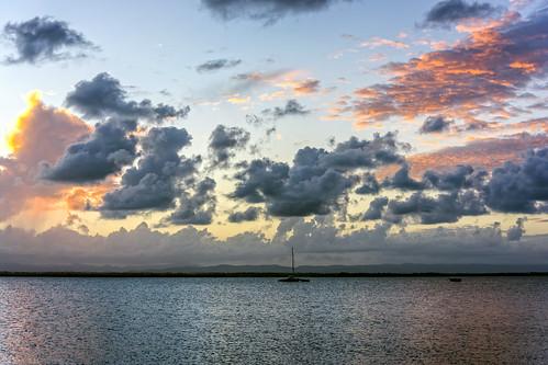 sunset sea sky water weather clouds sunsetsandsunrisesgold cloudsstormssunsetssunrises