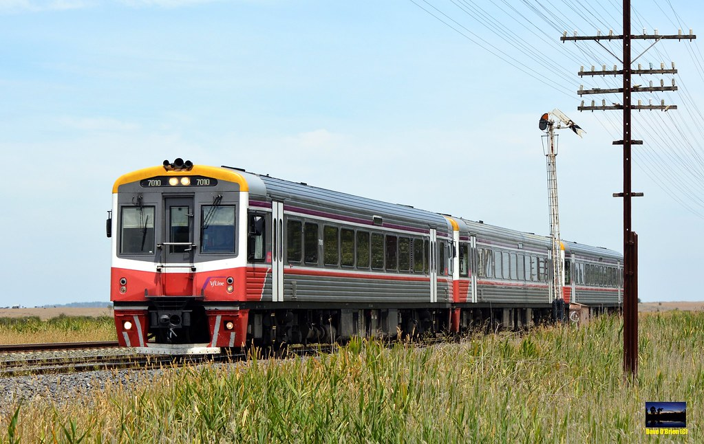Sprinter 7010 leads 2 classmates with 8317 Seymour pass, arriving at Wallan. 5/1/15 by Dave O'Brien