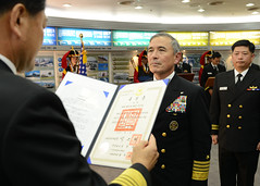 Republic of Korea Chief of Naval Operations Adm. Hwang Ki-chul, left, prepares to present Adm. Harry Harris Jr. the prestigious Korean Tong-il national defense medal Nov. 3 in Seoul. (U.S. Navy/MC1 Frank L. Andrews)