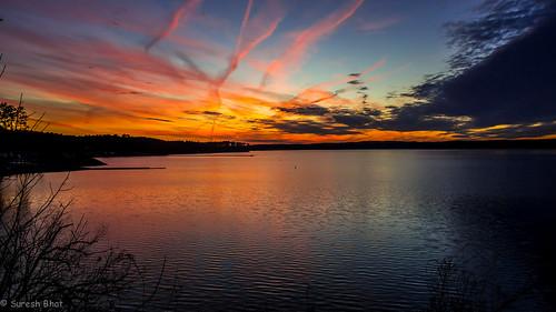 sunset red orange usa sun lake seascape landscape evening twilight scenery sundown dusk shoreline scenic northcarolina lakeside shore lakeshore blaze lakeview cary scenics waterscape waterview sunscape lakejordan lasthurrah sunsetoverwater scenicsnotjustlandscapes