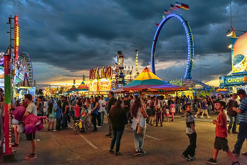 carnival sunset sky people newmexico fun lights cloudy dusk statefair albuquerque fair nm midway grantcondit