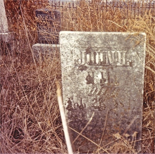 Even more recently friends and family visited the weed-choked graveyard Photo