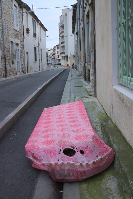 Pink bloated bedbase in a sullen street