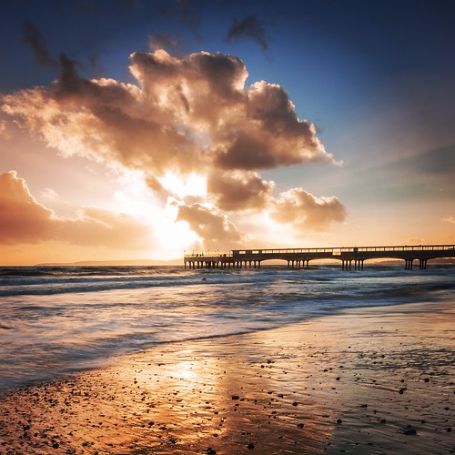 sunset sea clouds pier boscombe
