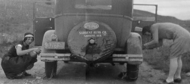 Schoolteacher Conda Edith Hoobler and Bookkeeper Esther M. Hoobler chaining up a 1928 Ford Model A.