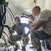 Joint Communication Support Element Operators Marine Corps Sgt. Landon Gilmore, Army Spc. James Hughes and Air Force Staff Sgt. Robert Carlisto perform a radio check with Cherry Point, N.C. after setting up a communications tent during an exercise at MacDill Air Force Base, Fla. The JCSE's core mission it to provide premier communications, anywhere across the planet. (U.S. Air Force photo/Master Sgt. Brian Ferguson)