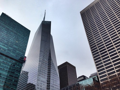 Buildings hovering above on a cloudy winter day in Manhattan, New York City. Seen is the Bank of America building, off Bryant Park. | by vmramos1