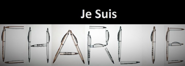 JE SUIS CHARLIE Black badges reading Je suis Charlie are being posted online after at least 10 journalists and two police officers were shot dead in a brutal gun attack on the French satirical magazine Charlie Hebdo