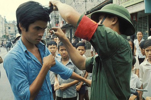 "The Fall of Saigon, Vietnam in April, 1975 - The Vietcong cutting hair and ""western"" clothes. 