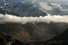 Thin veil of cloud over Chapursan Valley. North Pakistan