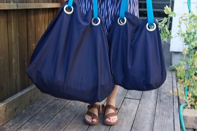 pair of blue Ikea bags