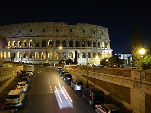 Night view of the coliseum from a bridge Rome