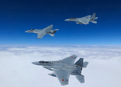 A U.S. Navy F/A-18E from VFA-27 flies in formation with two Japan Air Self-Defense Force F-15J Eagles during dissimilar air combat training near Okinawa, Japan. (U.S. Navy/Cmdr. Spencer Abbot)