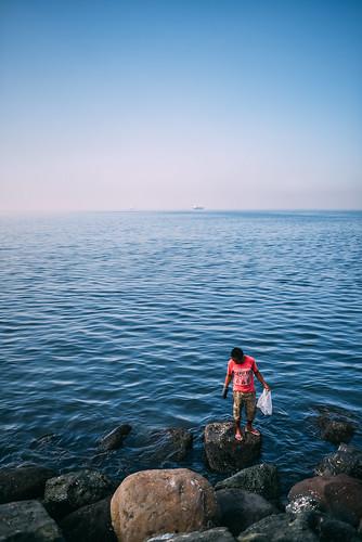 trip travel people urban seascape man beach asian bay nikon asia waterfront 28mm philippines shoreline manila d750 dailylife nikkor humaninterest