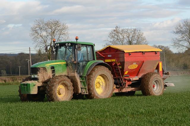 John Deere 7530 Tractor with a Bredal K65 Bulk Spreader