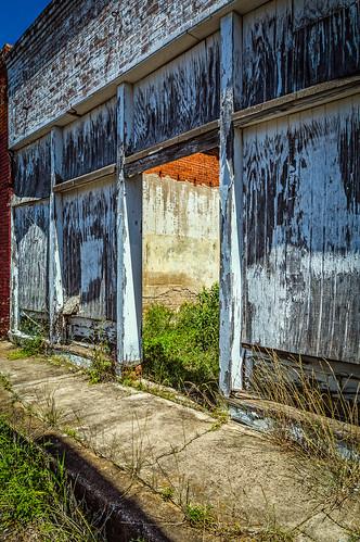 door old building brick abandoned us weeds peeling paint texas unitedstates sidewalk faded despair elkhart derelict