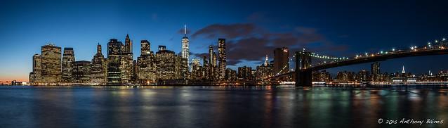 Lower Manhattan and the Brooklyn Bridge at sunset