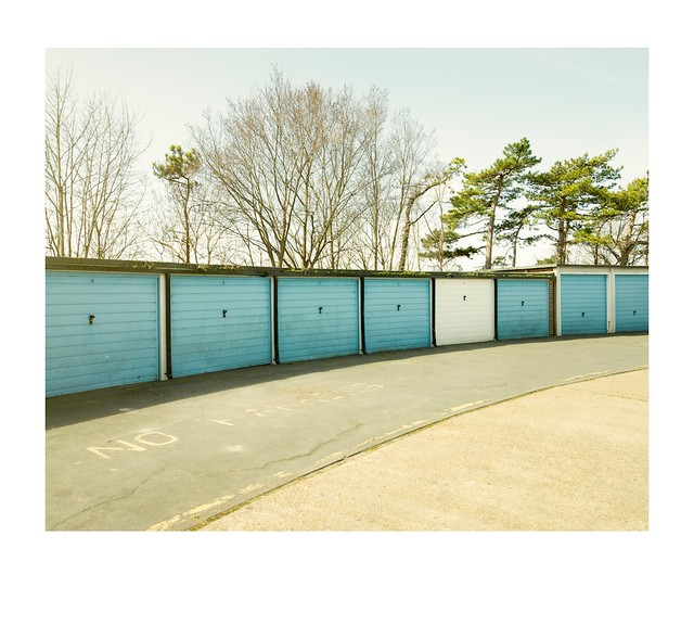 Garages, trees and sky.