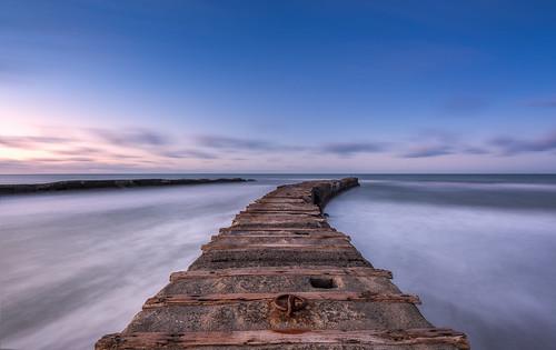 longexposure newzealand seascape sunrise blacksand wideangle nz northisland westcoast taranaki earlymorninglight colourimage patea leefilters nikond800 manabay lee06gndhard nikkor160350mmf40 solmetageotaggerpro2