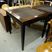 Tall darkwood and leather square table