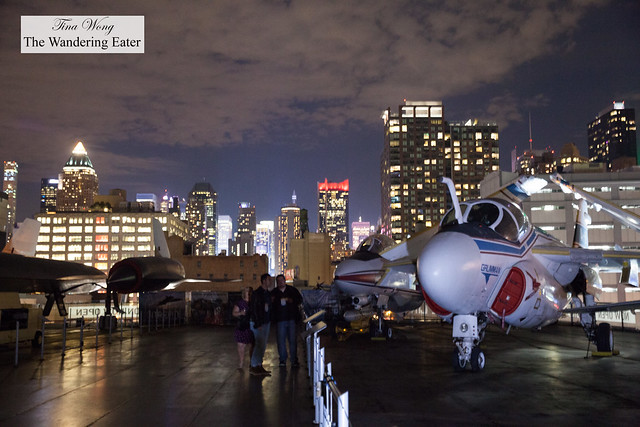 The vintage war planes and the surrounding Manhattan (west side) skyline