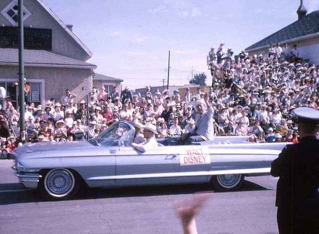 Walt Disney waves to the spectators