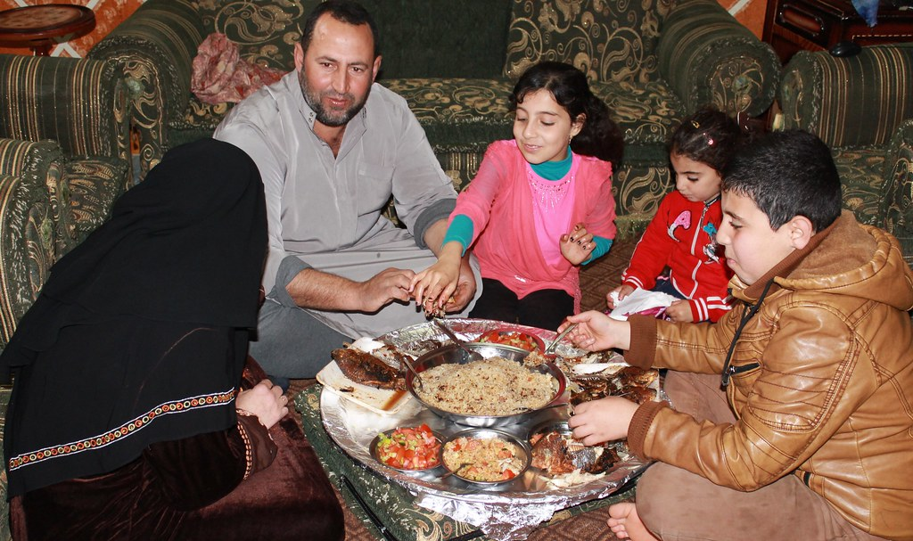 Sabri family eating fish for lunch in Abbassa, Egypt. Photo by Mona El Azzazy.