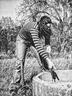 Jessica Fetching Water In Valgi, Estonia
