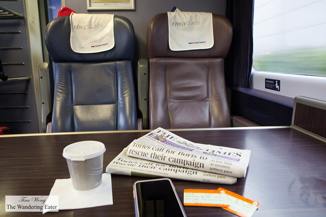 My coffee, tickets and newspaper while riding Rail Europe's First Class car