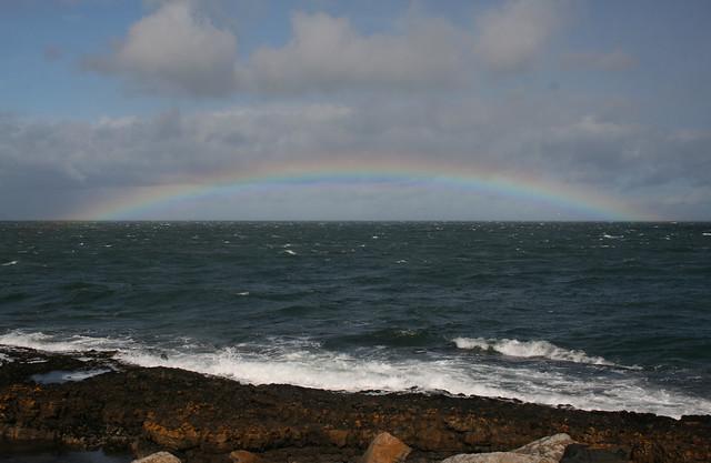 Rainbow over the waves